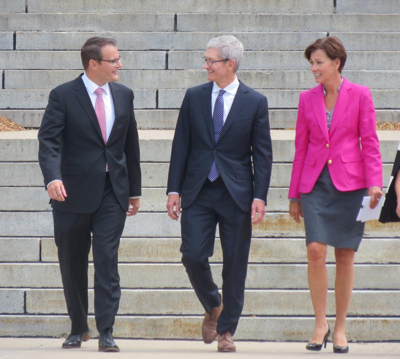 Acting Lt. Gov. Adam Gregg, Apple CEO Tim Cook, and Gov. Kim Reynolds