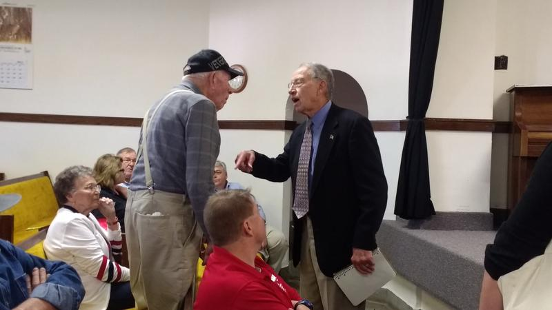 Grassley chats with a constituent before his town hall in Mount Ayr, Iowa.