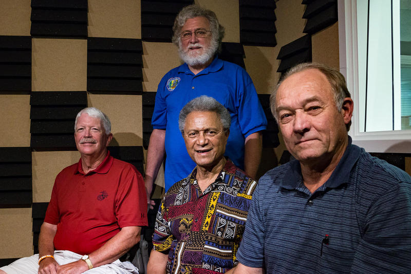 Vietnam veterans (left to right) Dan Gannon, Caesar Smith, Ron Langel, and Roger Elliott (standing) in IPR's Des Moines studio in 2015.