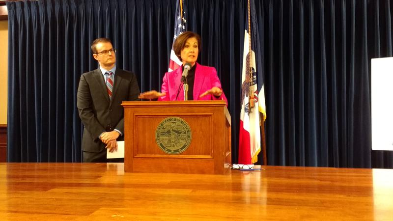 Gov. Kim Reynolds (right) and acting Lt. Gov. Adam Gregg address reporters during Oct. 10, 2017 press conference.