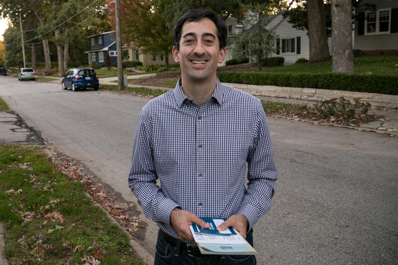Josh Mandelbaum, an environmental attorney, knocking doors in western Des Moines during his campaign for Des Moines City Council Ward 3 on October 16, 2017.