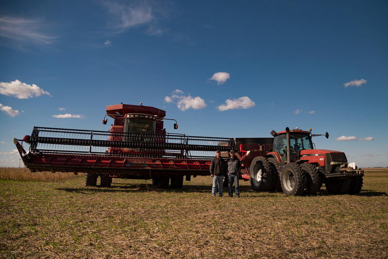 Greene County, Iowa farmers Tim and Schyler Bardole stand by their harvesting equipment near Dana, Iowa on October 23, 2017.