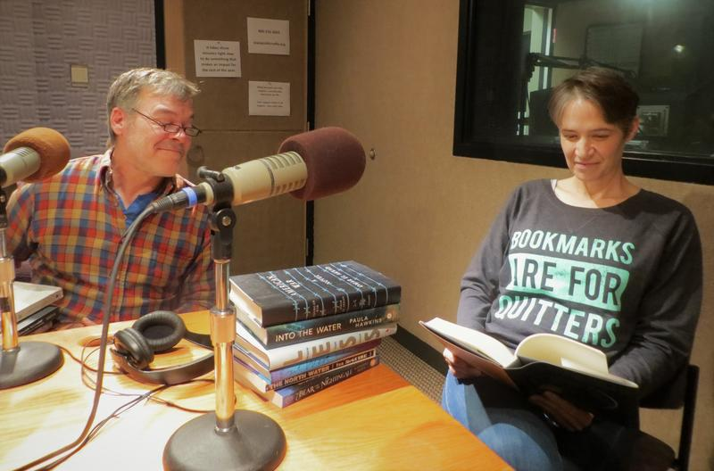 Tim Budd and Charity Nebbe sifting through some of Tim's favorite books of the year.