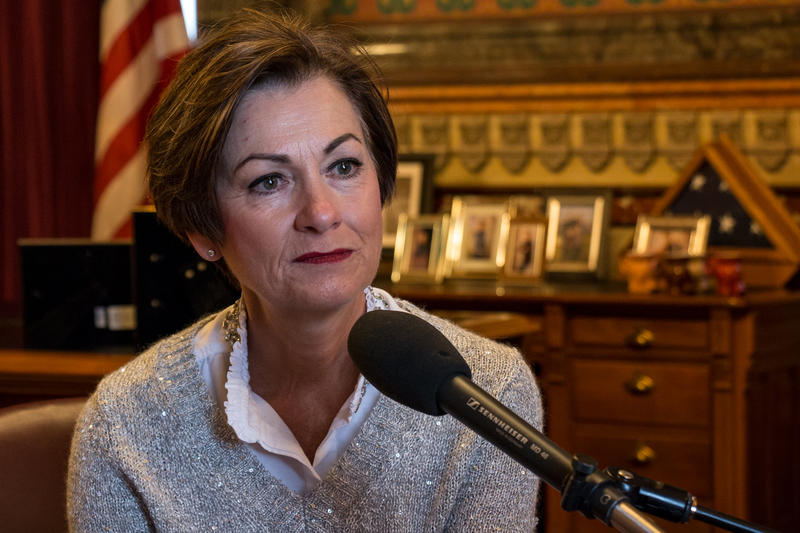 Iowa Governor Kim Reynolds speaks with IPR reporters in her formal office at the capitol.
