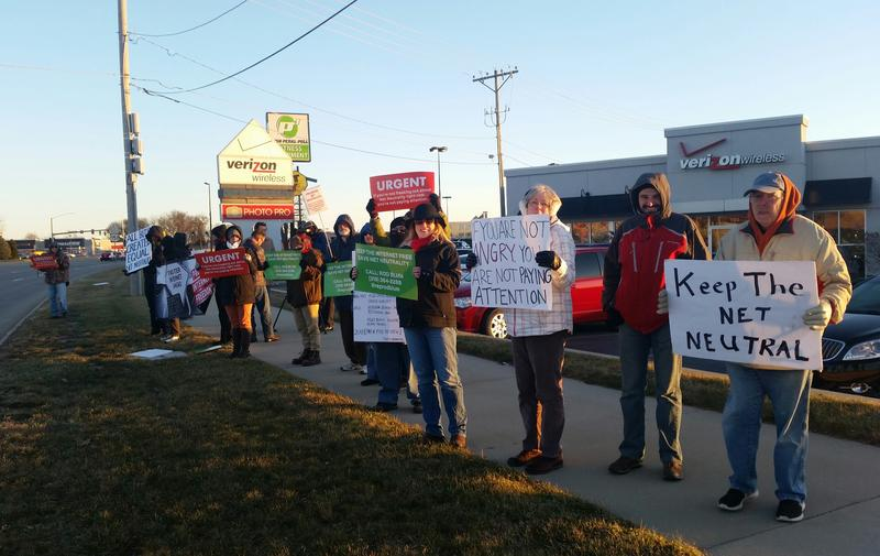 Net Neutrality supporters protest outside a Verizon Wireless store on Collins Road in Cedar Rapids.