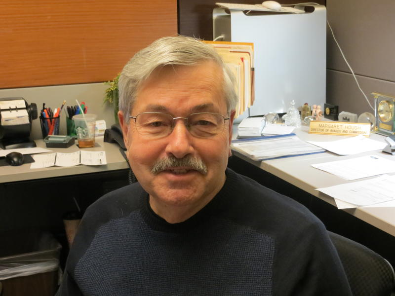 U.S. Ambassador to China Terry Branstad, working at a desk in the govenror's office while on a visit back to Iowa