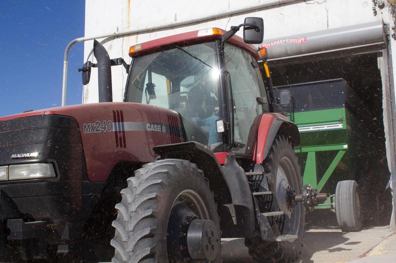 A tractor pulls a grain cart through an elevator in central Iowa.