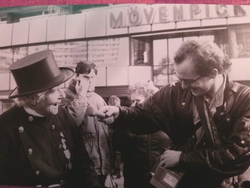 Ben Kieffer interviewing an East German organ grinder in West Berlin the day after the fall of the Berlin Wall in 1989.