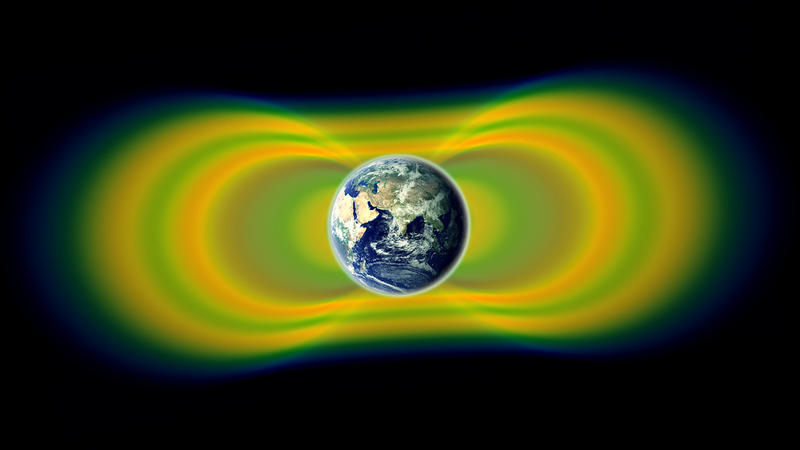 Two giant swaths of radiation, known as the Van Allen Belts, surrounding Earth were discovered in 1958. The radiation is shown here in yellow, with green representing the spaces between the belts.
