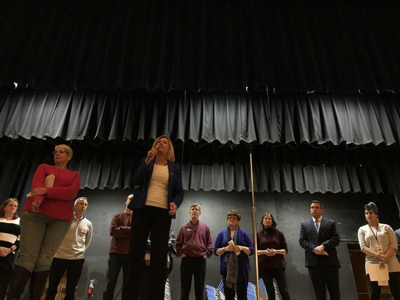 Democratic gubernatorial candidate Andy McGuire pitches herself to caucus-goers in the Roosevelt High School Auditorium in Des Moines during the Iowa Caucuses on Feb. 5, 2018