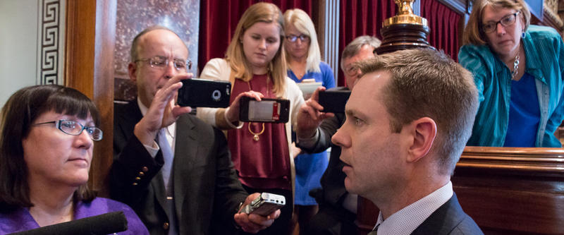 Senator Charles Schneider answers questions with reporters about senator Dix's unexpected resignation