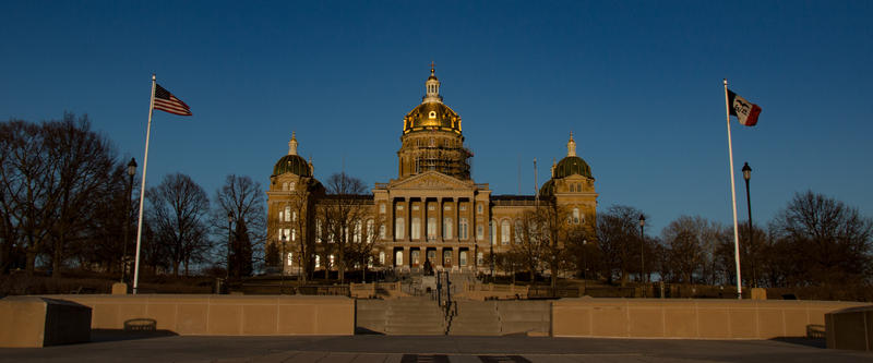 Iowa's Capitol as the evening sun shines on its golden dome.
