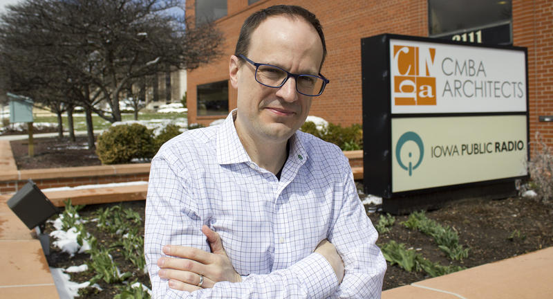 Kyle Munson stands outside IPR's Des Moines bureau.