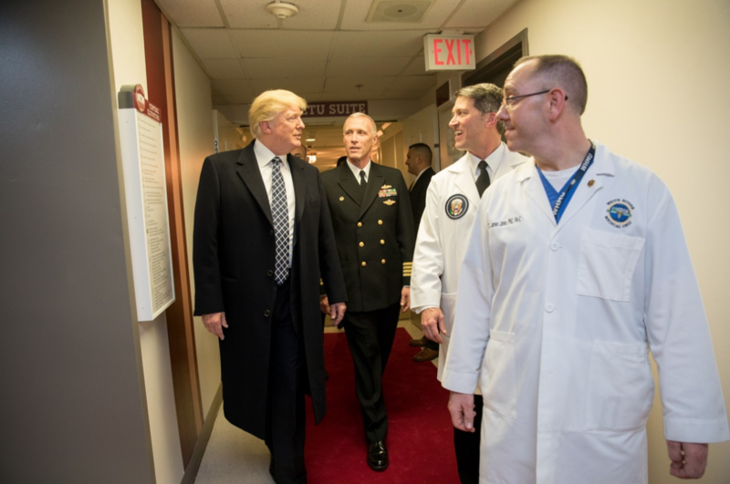 President Donald J. Trump talks with, from left to right, with Capt. Mark Kobelja, Director of Walter Reed National Military Medical Center; Dr. Ronny Jackson, Physician to the President; & Dr. James Jones, physician to the President