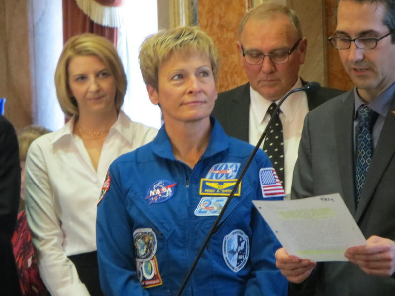 Astronaut Peggy Whitson with Rep. Amy Nielsen (D-North Liberty);  Rep. Cecil Dolocheck (R-Mount Ayr); and Rep. Joel Fry (R-Indianola)