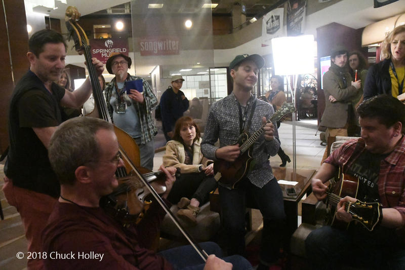 A band jamming in the lobby at the Folk Alliance International conference.