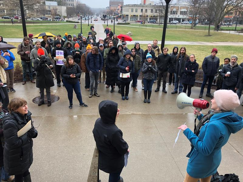 A crowd of non-tenure track faculty and supporters gathers on the UI campus to demand higher pay and more representation.