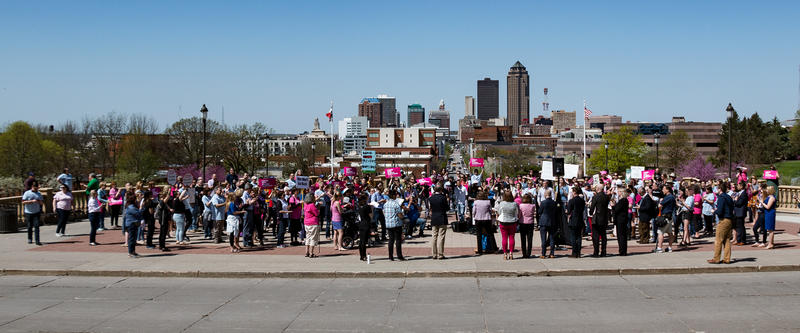 Protesters gather on the Capitol steps to voice opposition to anti-abortion bills passed during the Iowa legislature.