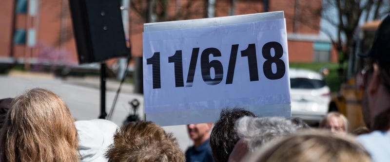 A protester's sign bears the date of the November election when two-thirds of the legislative seats will be up for a vote, as well as the governor's office.