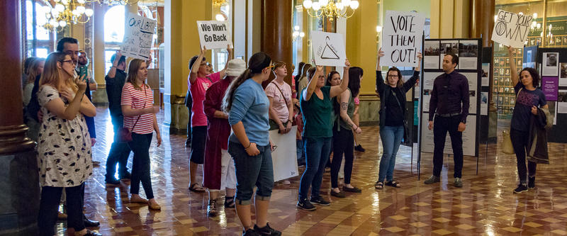 Protesters of the anti-abortion bill shout in the Capitol's Rotunda as Gov. Reynolds signs SF-359 into law.