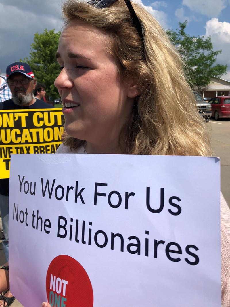 Ashley Burns was one a handful of protestors outside of Wednesday's bill signing cermony.