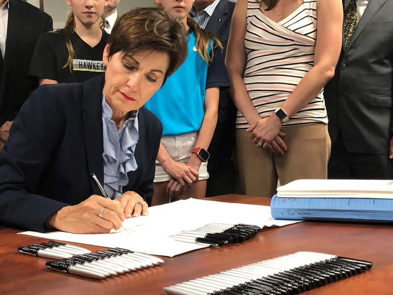 Governor Kim Reynolds signs into law SF 2417.