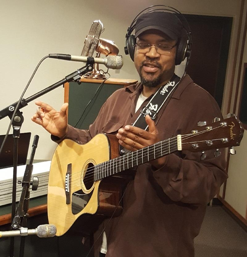 Todd Stevens performs a Water Rocks! song in IPR's Ames studio