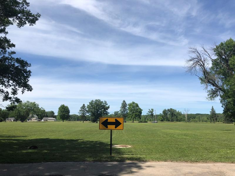Dozens of homes were demolished in the Northwest neighborhood of Cedar Rapids, leaving behind open grassy fields dotted with trees and a handful of remaining houses.