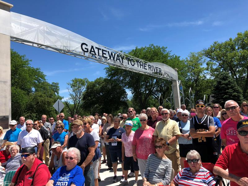 Cedar Rapids residents at a dedication ceremony for a memorial recognizing the impacts of the 2008 floods.