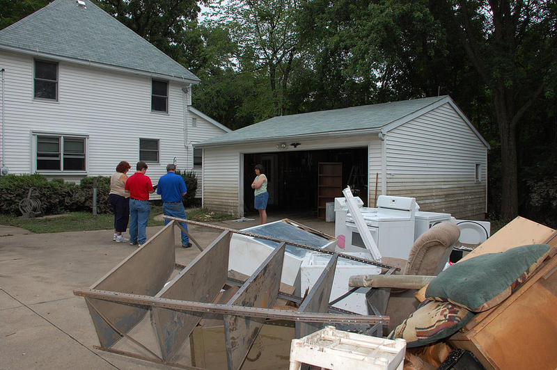 Manchester, IA, July 28, 2010 -- FEMA and state officials, along with a representative from the Small Business Administration, talk with a local survivor during the first response phase of the flood recovery.