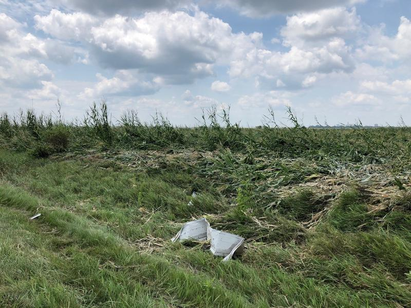 A tornado that touched down near Pella on July 19th flattened acres of corn and littered fields with debris