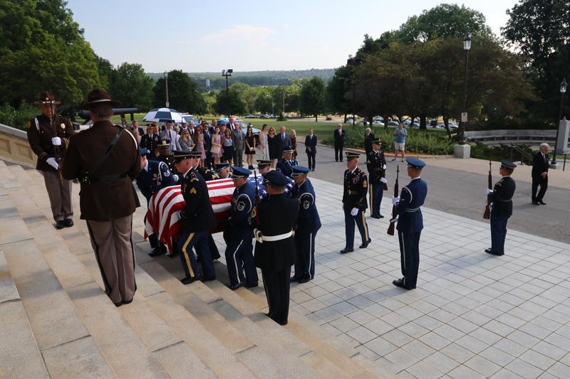 The body of former Gov. Robert D. Ray is brought into the Capitol Thursday afternoon, where it lay in state into the evening.