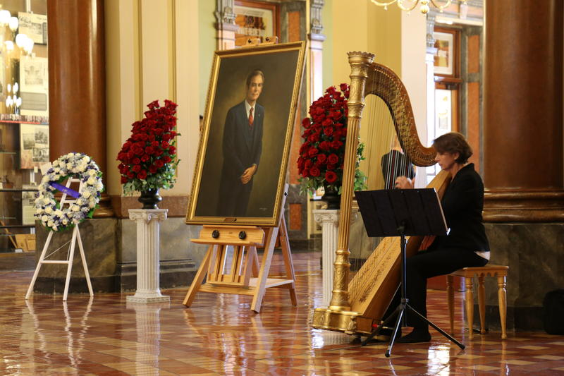 A harpist provides music for the visitation.