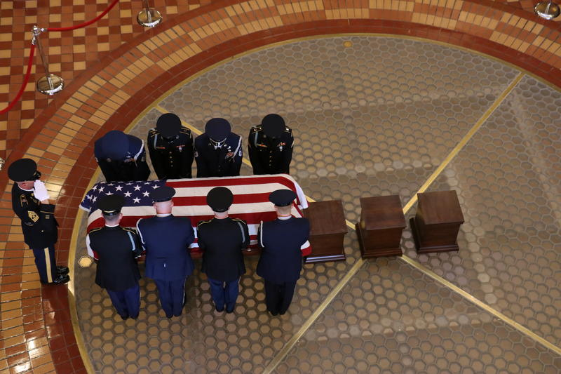 The body of former Gov. Robert D. Ray is brought into the rotunda.