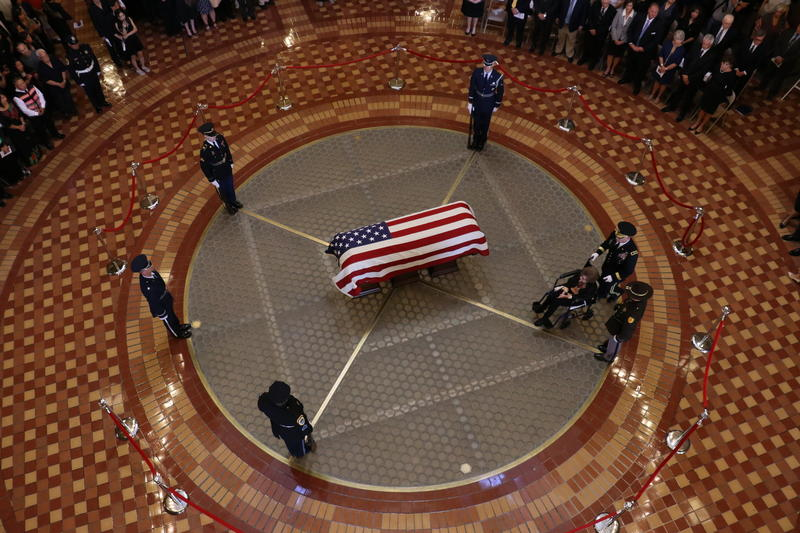 Gov. Ray's widown, Billie Ray, is brought to her husband's casket.