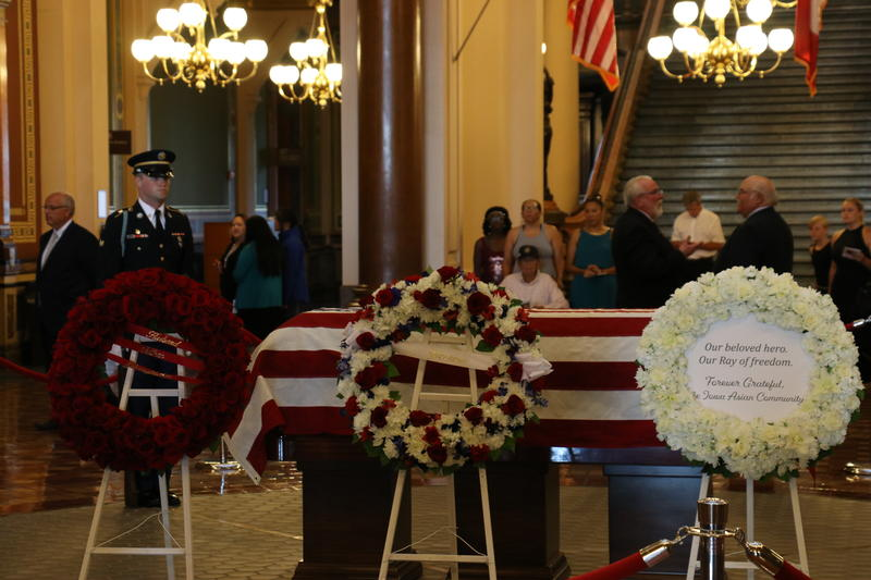 The body of former Gov. Robert D. Ray lies in state in the Capitol rotunda.