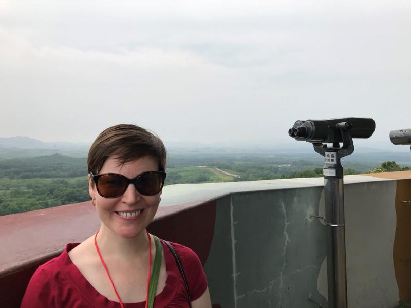 Professor Mary McCarthy at the Dora Observatory in the Demilitarized Zone with North Korea in the distant background