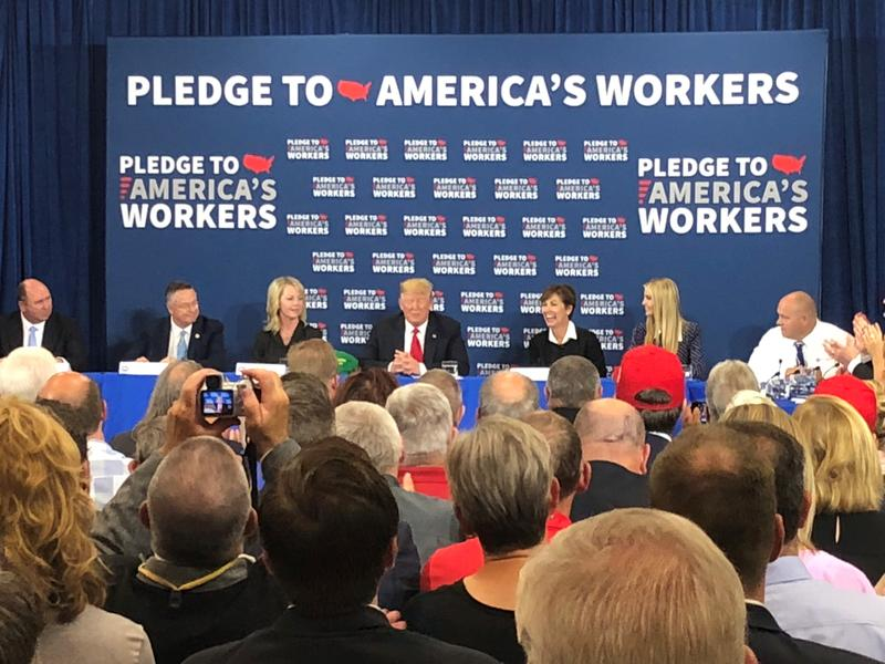 President Donald Trump visited Peosta, Iowa Thursday to highlight workforce development. But the conversation quickly turned from policy to discussions of politics and trade.