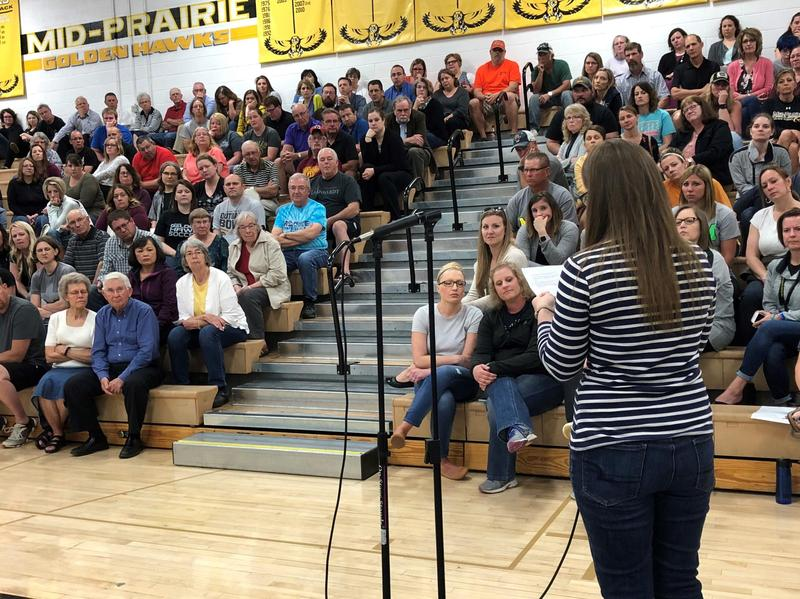 In this May 2018 photo, a woman who alleges Trent Yoder targeted her when she was a student in western Iowa addresses the audience at a Mid-Prairie school board meeting.