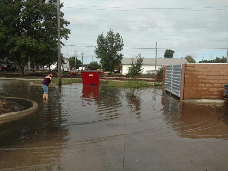 Flash floods swept through the parking lot of the Johnson County Crisis Center, washing several inches of water into the organization's offices.