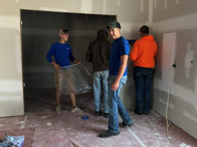 Students from West Branch and Durant High Schools are among those who placed walls, installed electrical wiring and plumbing, laid drywall, roofed and painted a home in south Iowa City.