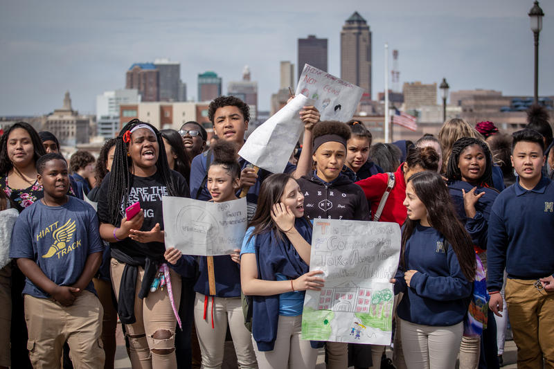Nearly 3,000 students from Des Moines Public Schools participated in the National School Walkout, marking the anniversary of the shooting at Columbine High School and calling for action against gun violence.