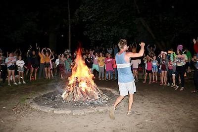 The rowdie campfire at YMCA Camp Wapsie happens on Monday night. Campers and counselors gather around a huge bonfire to sing and scream their favorite camp songs and chants.
