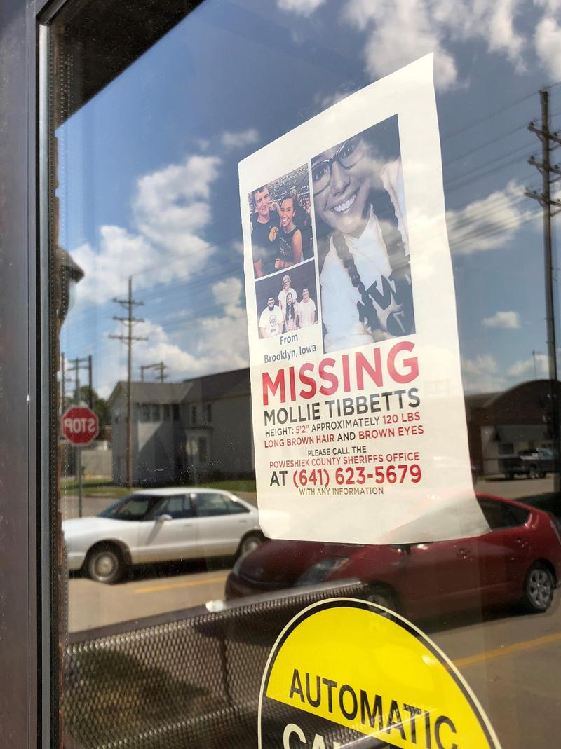 Signs seeking information connected to Mollie Tibbets' disappearance have appeared throughout central Iowa.