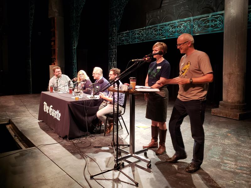 Ben Kieffer and Erin Jordan on stage at Theatre Cedar Rapids, moderating a Pints and Politics panel discussion