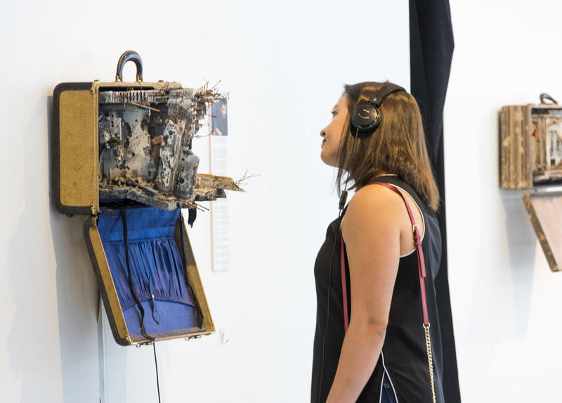 "A scene from the exhibit ""Unpacked: Refugee Baggage"""
