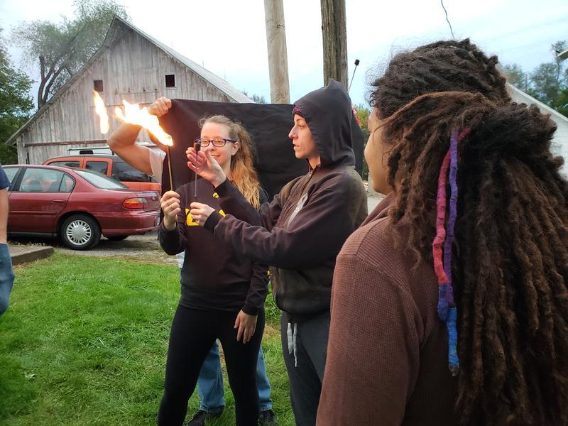 Brittney Marine leading a workshop on fire breathing in Iowa City