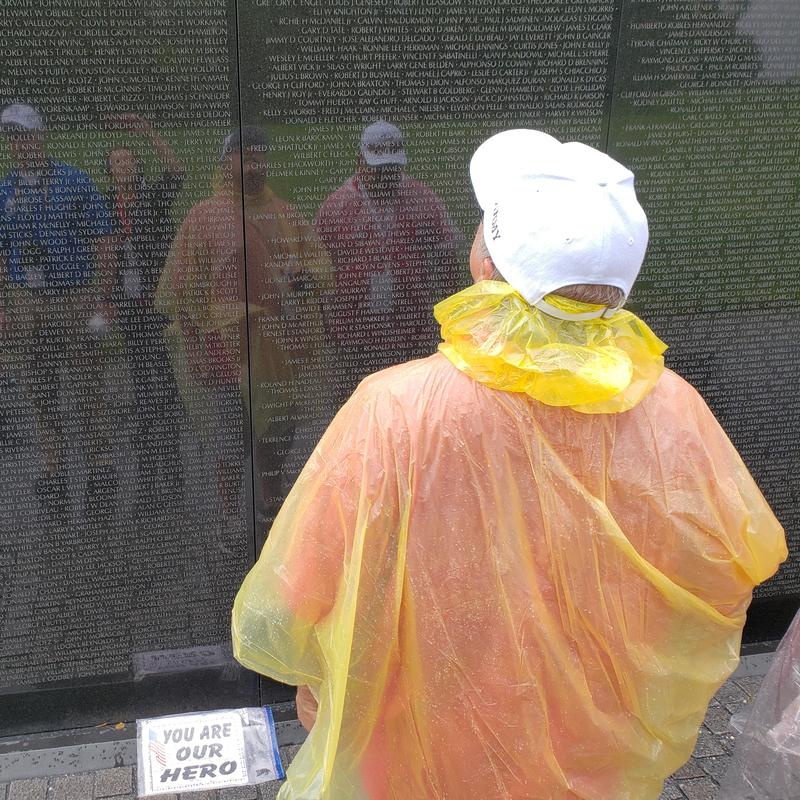 A veteran looks upon the Vietnam Veterans Memorial Wall