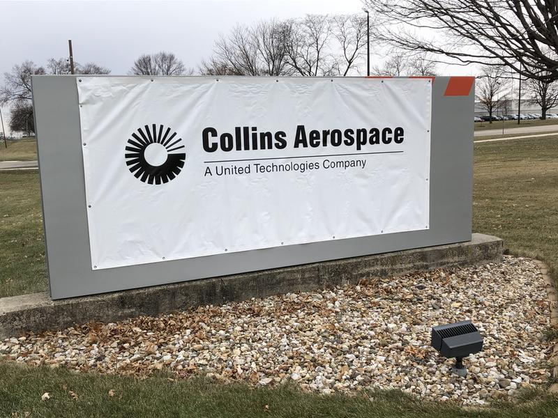 By Wednesday, a temporary Collins Aerospace sign covered the old Rockwell-Collins sign in front of the company's Cedar Rapids facility.