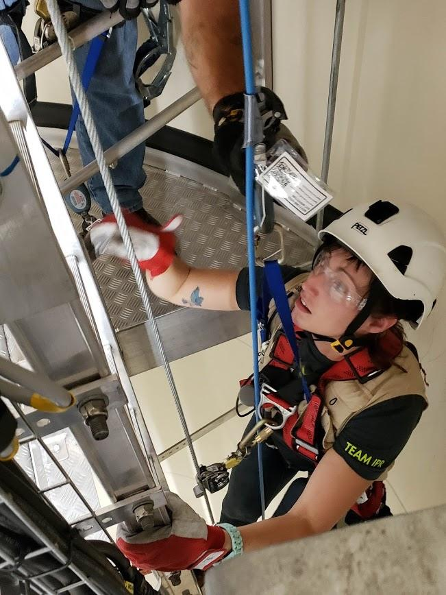 Producer Lindsey Moon climbs Tower 93 at Mid-American Energy's North English Wind Farm.